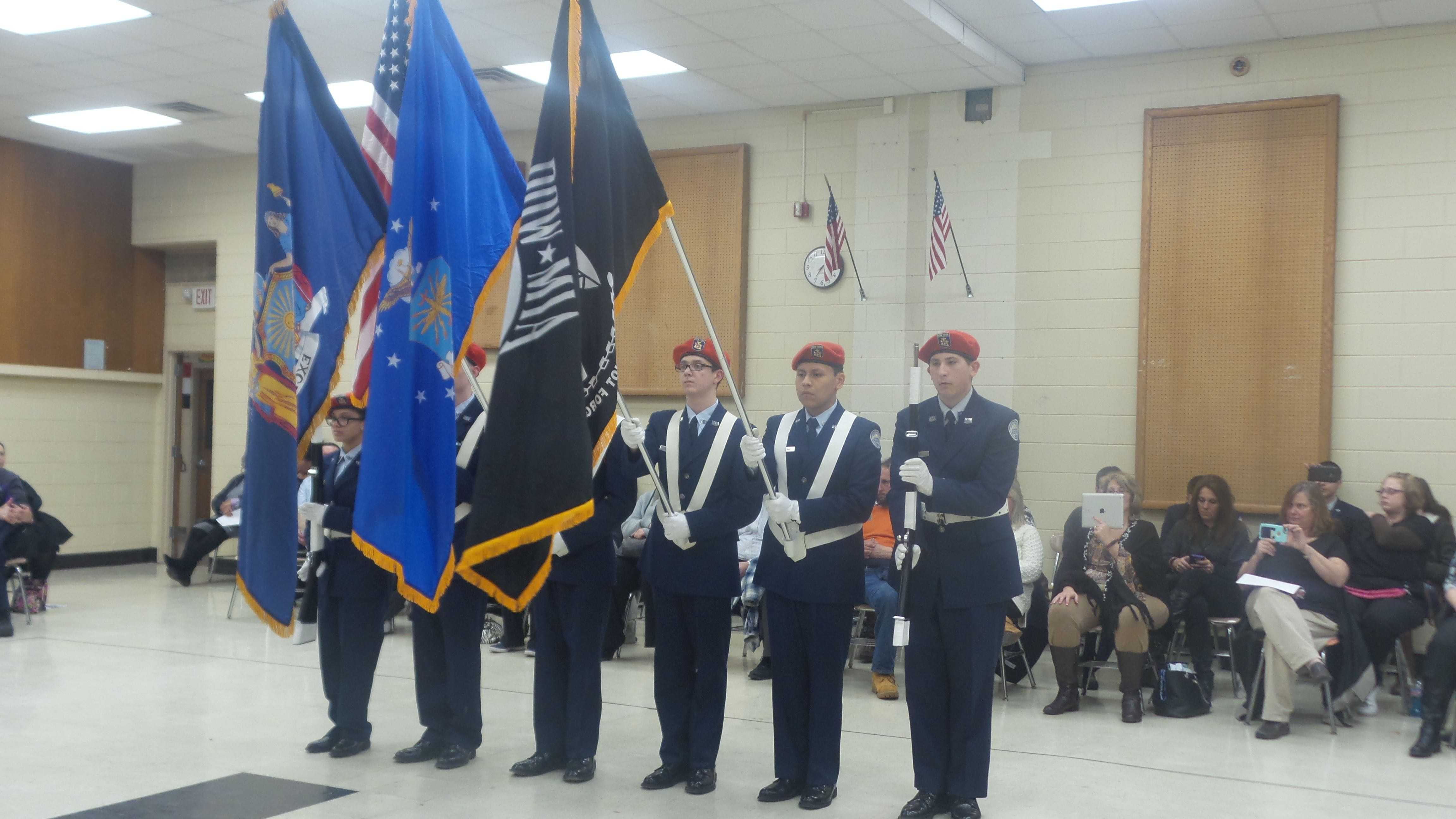 ROTC  students presenting the colors.
