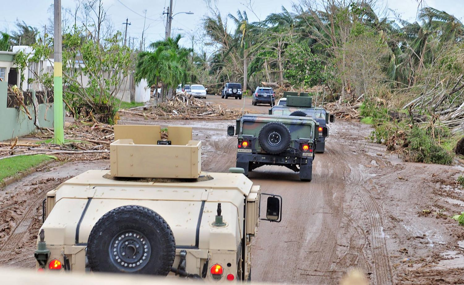 The PR National Guard drives through some of the devastated areas of remote villages after Hurricane Maria tore through the island.