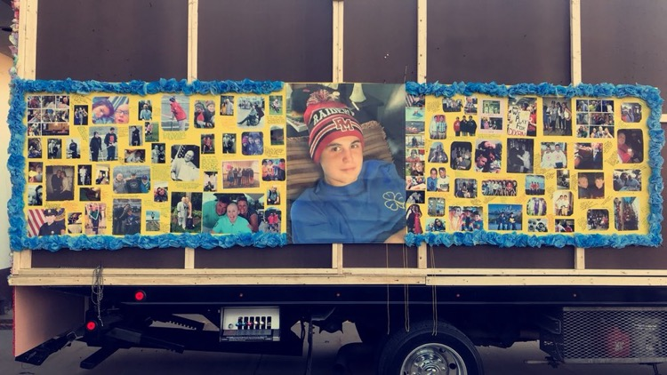 The+junior+class+paid+tribute+to+their+classmate%2C+Sean+Dixon%2C+who+lost+his+battle+to+cancer+a+few+days+before+Homecoming.+Students+shared+photos+and+created+a+beautiful+collage+on+the+back+of+their+float+to+send+down+Main+St.