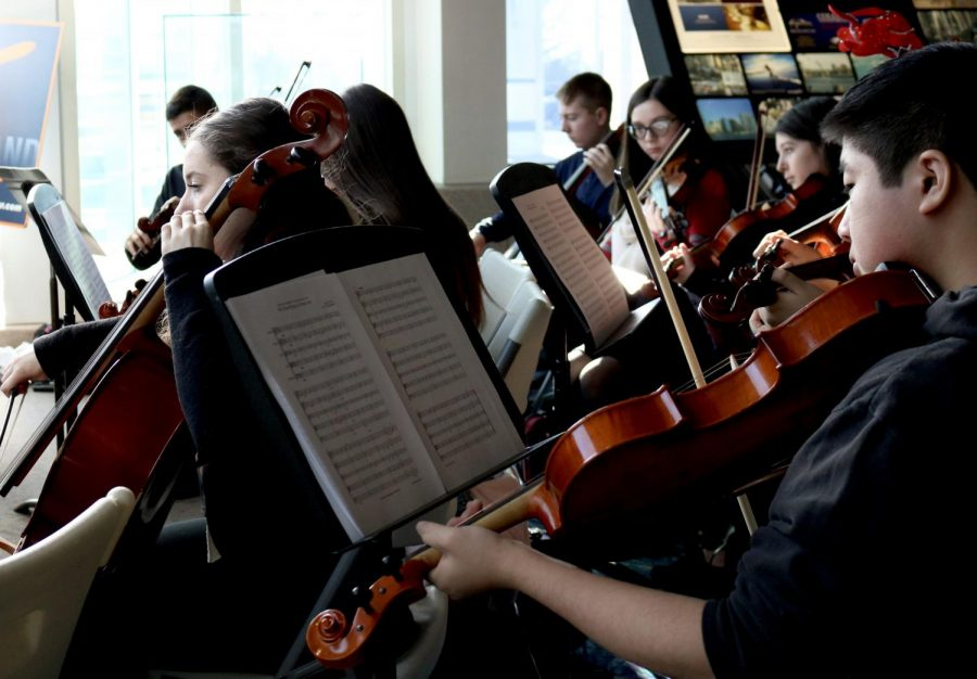 Orchestra+students+participate+in+events+beyond+the+traditional+school+concert.+Each+year%2C+they+perform+free+for+the+public+at+the+airport+welcoming+arrivals+to+Long+Island+and+serenading+waiting+passengers+to+get+them+in+the+holiday+spirit.+