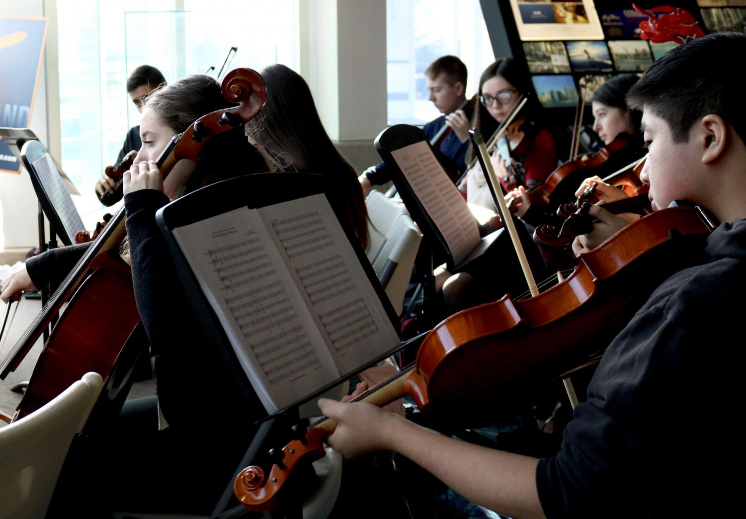 Orchestra students participate in events beyond the traditional school concert. Each year, they perform free for the public at the airport welcoming arrivals to Long Island and serenading waiting passengers to get them in the holiday spirit.