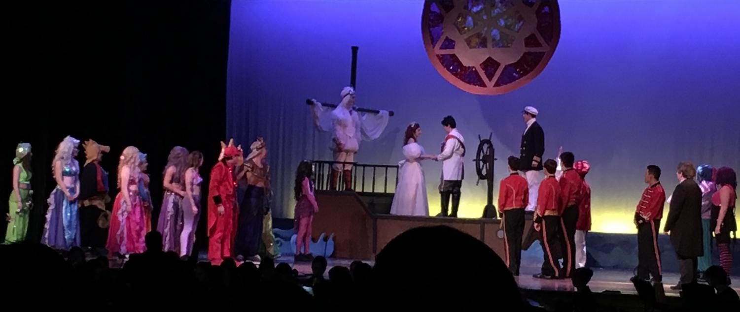 Pat-Med students on stage during the final scenes of The Little Mermaid.