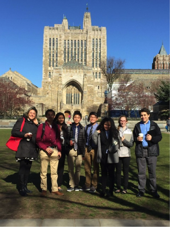 Students and Model UN advisor Ms. Botta stand in front of the Yale University Sterling Memorial Library.