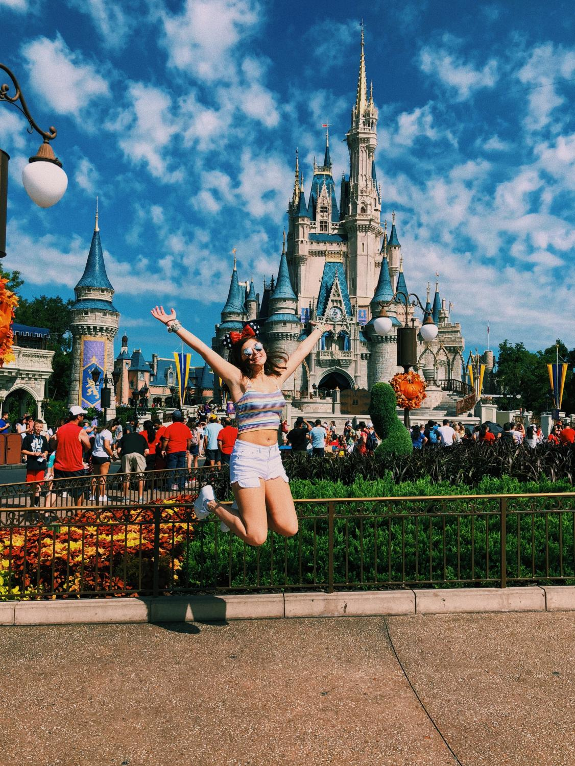 Jumping for joy. THIS is what it feels like when you have your first trip to Disney.