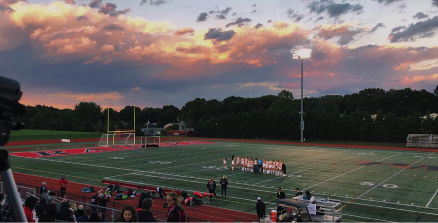 The+Pat-Med+Varsity+Field+Hockey+Teams+lines+up+together+for+the+last+time+before+their+final+game+under+the+lights.+Tonight+was+Senior+Night+and+those+teammates+were+honored.