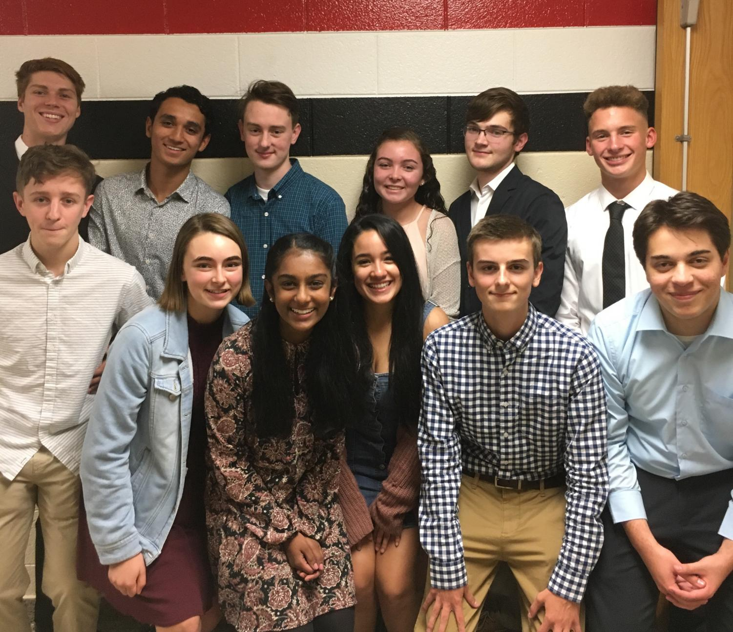 Juniors and seniors pose together backstage before being inducted into the National English Honor Society Wednesday evening.