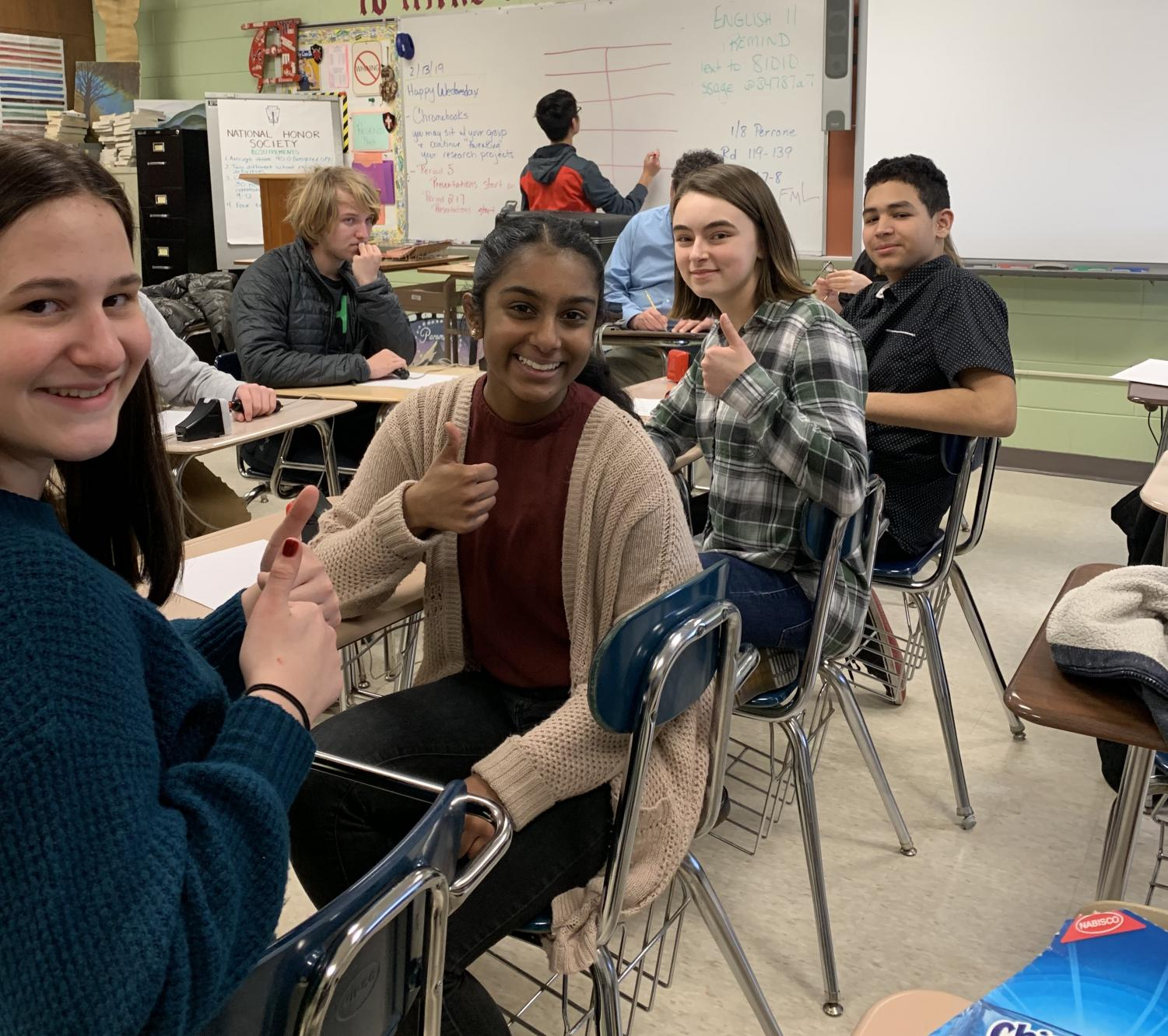 Juniors Sarah Varghese and Meghan O'Leary (2nd and 3rd from left) and Sophomore Jeff Tajada offer a thumbs up to encourage newcomer, Esme Warmuth, gr. 9 for her first competition.