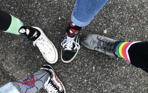 PMHS students showing off their crazy socks in support of Down Syndrome Day