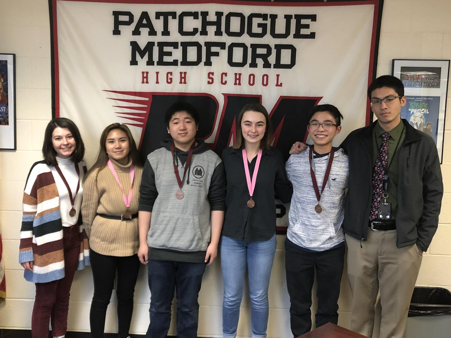 (From left to right) Elizabeth Niemiec, Francine Tongol, Evan Zhang, Meghan O'Leary, and Justin Zhou. The Science Olympiad competition was on January 26th at Ward Melville High School.
