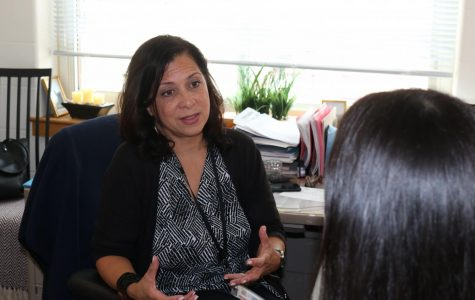 PMHS social worker, Mrs. Rosario, speaks with a student about resources available in our high school for students that need support.