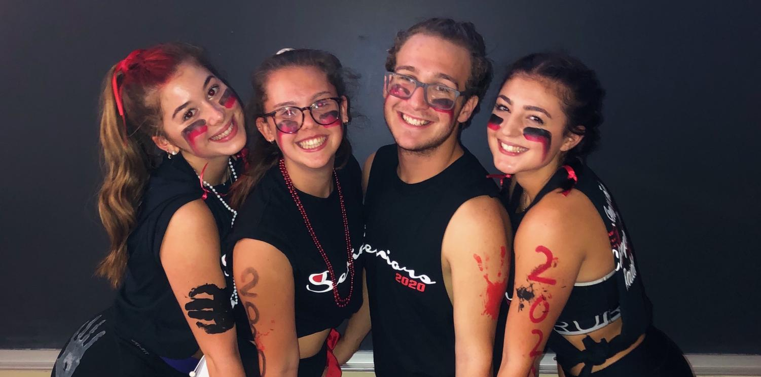 Seniors Erin, Phoebe, Hunter, & Jessica posing together on one of the first major events to mark Senior year, Raider Bowl.