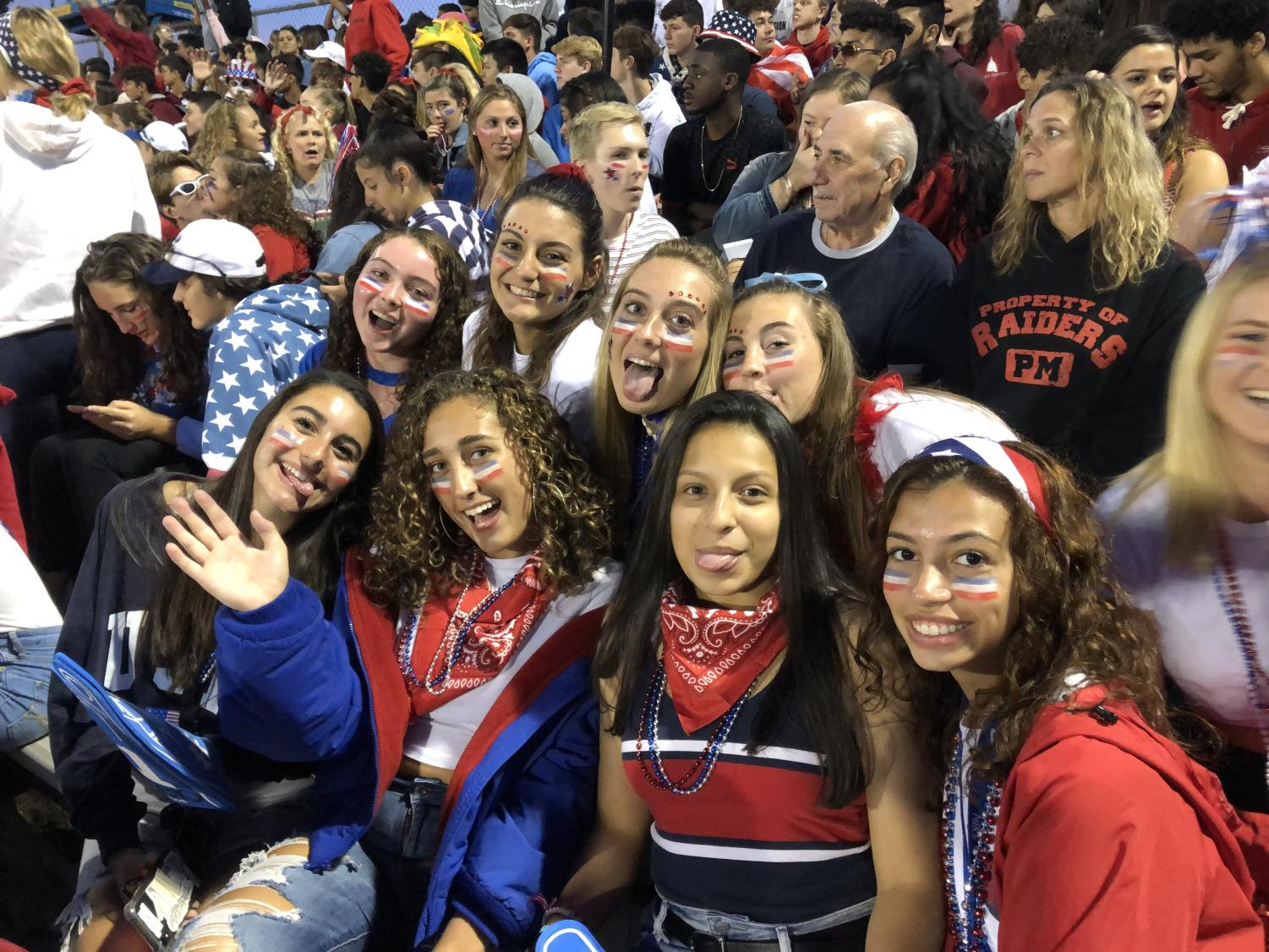 Bottom then top left to right Seniors  (Jessica Panzarino, Shannon Donnelly, Brianna Perez, Makayla Mateo, Stephanie Sheridan, Madison Wyatt, Olivia Hofer and Ana Seifert) showing school spirit in red white and blue at the first themed football game.