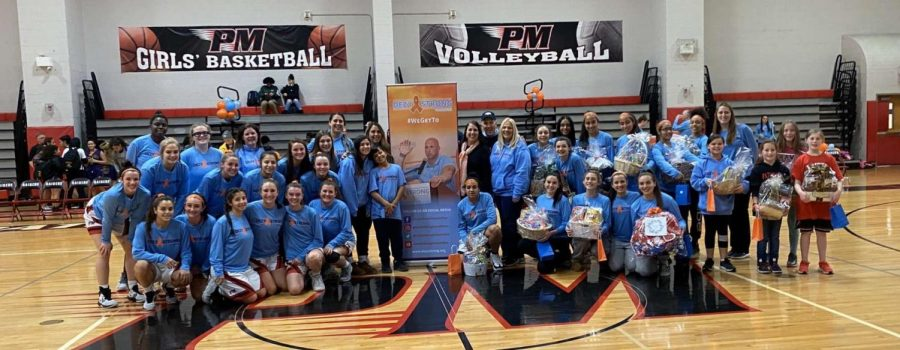 The girls basketball team representing PMHS in support of Dezy Strong Foundation.