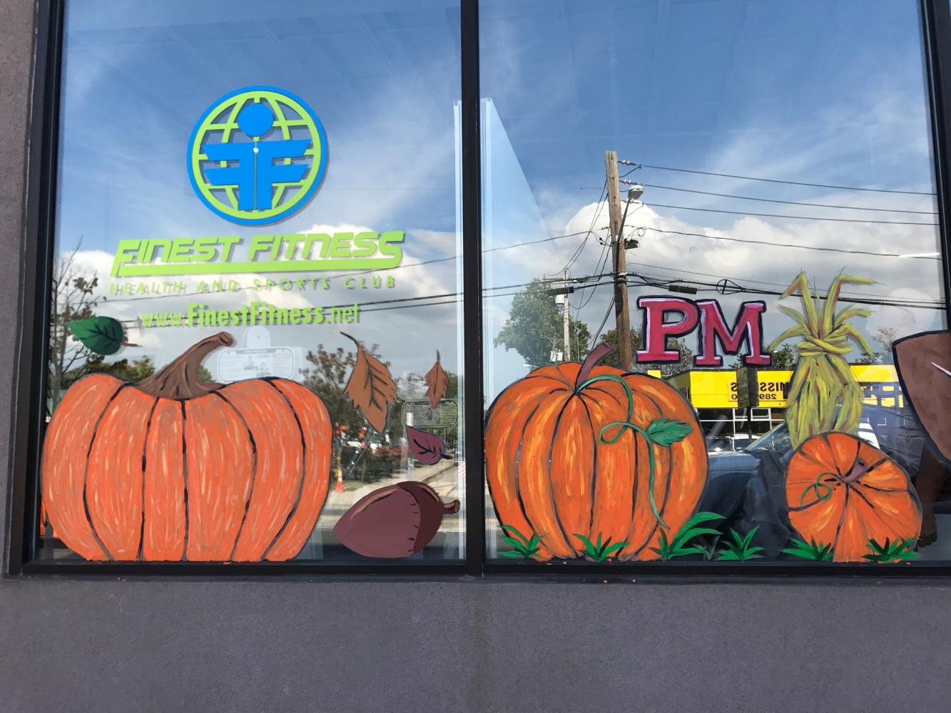 Seasonal Storefront Window Art By >> Art Students Falling Into The Homecoming Season The Red Black