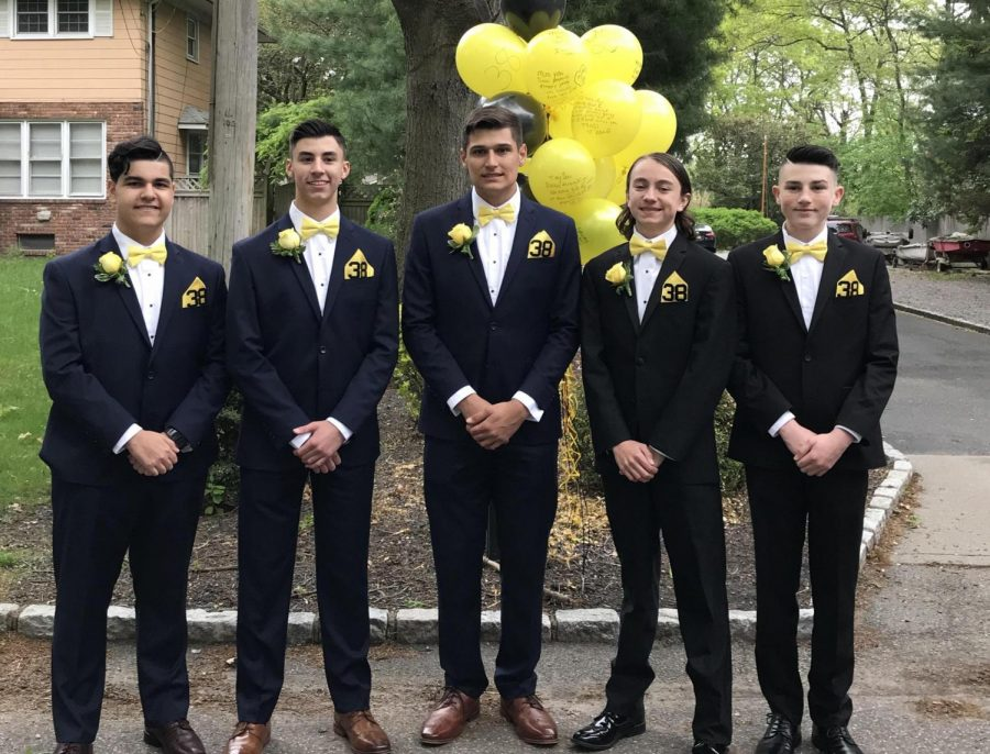 PMHS juniors wear yellow bow ties and #38 in honor of Sean Dixon to their junior prom.