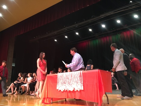 "Pictured above is Molly McCabe, an 11th grade chorus student, receiving her certificate from Mr. Zarchy, and greeting the other music educators as well. After the ceremony, Molly stated ""It's a great honor to be inducted in a society with such a great group of students."""