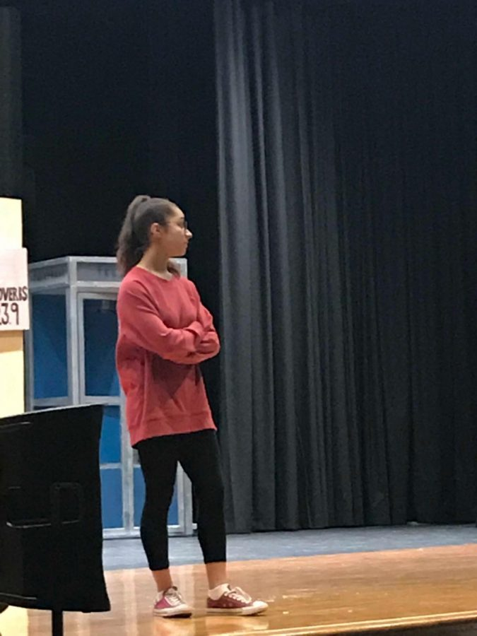 Annie Rodriguez, playing Sarah Brown poses onstage during rehearsal.