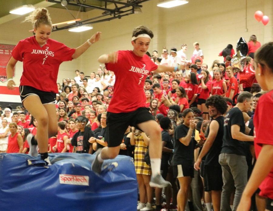 Maddy & Adam leap over the mat during the Juniors' obstacle course run.