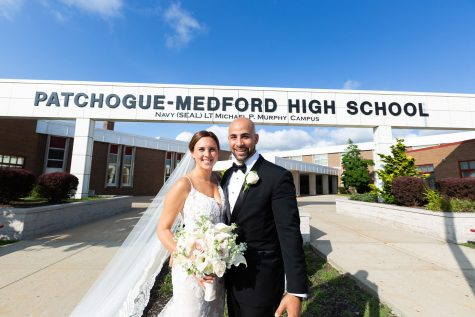 Caitlin and Michael Rattien took some time from their wedding day to capture pictures outside the high school in commemoration of their meeting eleven years prior as high school sweethearts.