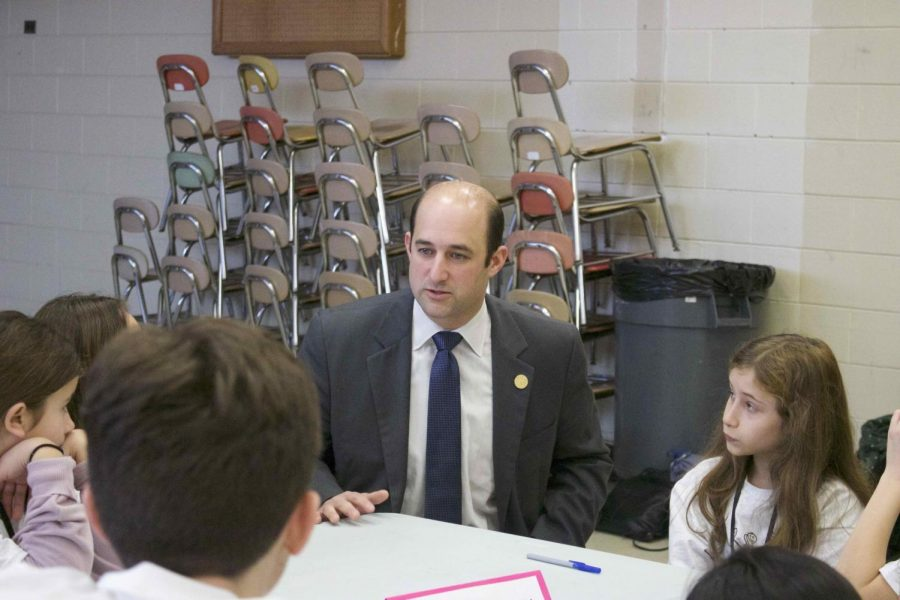 Suffolk County Legislator, Rob Calarco talks to junior journalists from Eagle Elementary about the Canaan Lake and Carnegie Library projects that helped restore important landmarks in our community.