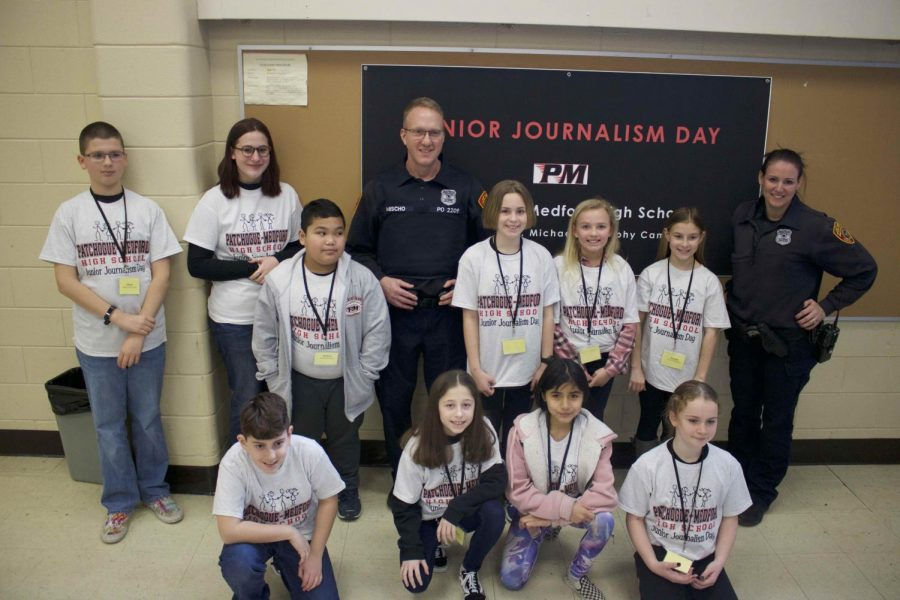 Junior journalists from Medford elementary pose with COPE officers at Junior Journalism Day 2020.