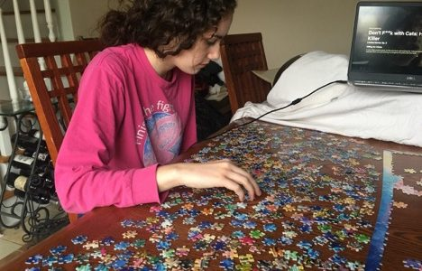 Pat Med senior, Julia works on completing a 1,000 piece puzzle as school shutdown state-wide amid the COVID-19 outbreak.