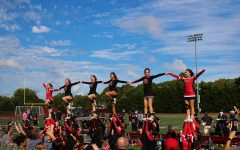 Pat-Med JV and Varsity teams doing stunts during the football game.