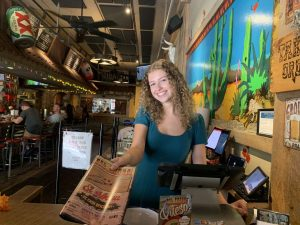 PMHS senior, Nicole Pattogen, working as hostess at Del Fuego on Main Street in Patchogue.
